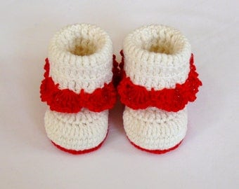 White crochet baby booties for a girl.