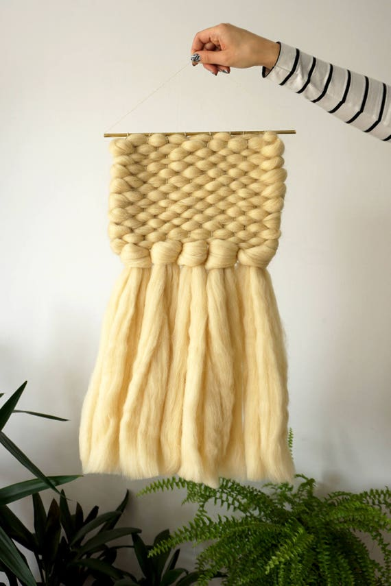 Middle chunky wall hanging with golden details