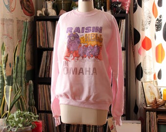 vintage 1980s sweatshirt . Raisin hell in Omaha Nebraska . California Raisins spoof on pink Jerzees sweats, size large . NEVER WORN