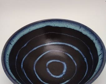 Functional wheel thrown bowl.Decorated with wax resist.