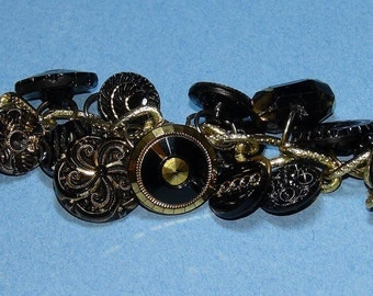 Custom made, each one differnt. Black glass onyx Victorian / Steampunk button charm bracelet.