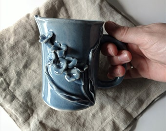 Spring flowers blue Mug. Sculpted porcelain handmade coffee mug. Modern ceramics, one of a kind coffee cup, slab built, medium blue.