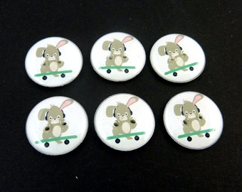 """6  Rabbit or Bunny  on Skate Board Buttons.  3/4"""" or 20 mm round Buttons for Sewing. Washer and Dryer Safe.  Easter Buttons."""
