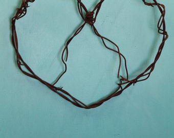 rusted double strand wire heart - barbed wire wrapped