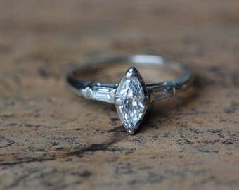 Vintage 1940s marquise diamond 1/2 carat engagement ring with baguette accents