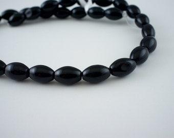 12mm Black Onyx Gemstone Capsule Beads - 15 inch strand - 31 pieces