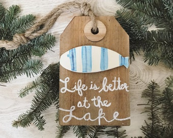 Life is better at the lake hanging fish sign