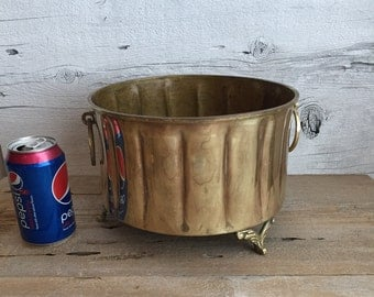 Brass planter with feet and handles. Large round brass planter.