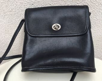 Vintage black leather small Coach bag cross body turn buckle
