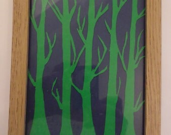 Woodland, paper cut trees, silhouette in wood effect frame.