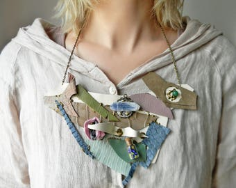 Steampunk couture leather bib necklace with raw kyanite crystal, Statement avant garde necklace Trending necklace Mixed Media funky necklace