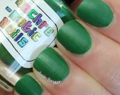 Against All Logic Nail Polish - matte green with blue sparkle