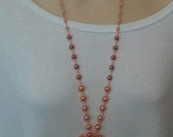 Long Peach colored beaded necklace