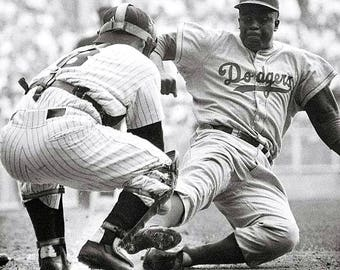 Jackie Robinson stealing home.
