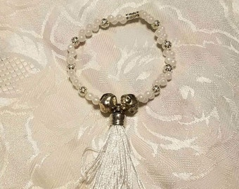 Streatchable string with tiny white glass beads makes this danti bracelet