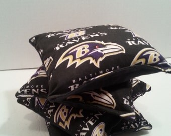 """Corn Hole Bags.  Baltimore Ravens Custom Cornhole Bags. Triple stitched bags for Corn Hole Boards.  6"""" x 6 """". Football themed. Picnic games."""