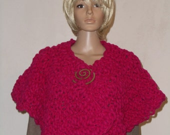 Knitted thick short Cape in pink with wooden spiral as closure