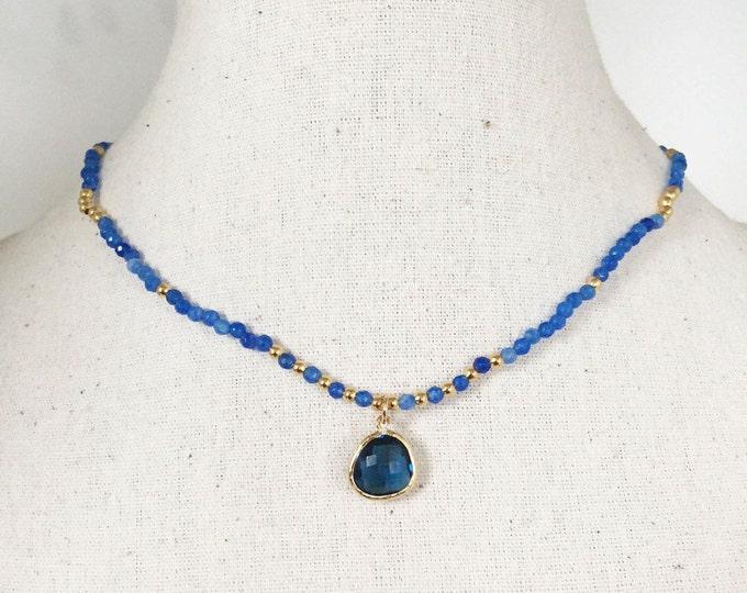 RAS neck beads and blue agathe pendant