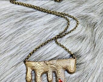 Stalactite. Cuttlebone cast brass with garnet necklace.......................................................boho hippie nature spelunk cave