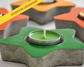 Candlestick star cement. Candle holder star concrete in vivid colors, decoration of garden or terrace. Concrete candle holder.