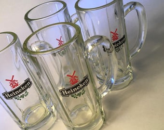 Set of four Heineken thick and heavy glass beer mugs