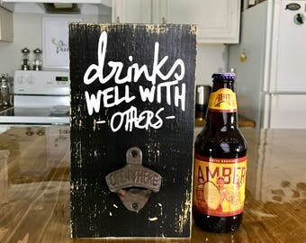 Drinks well with others Bar Sign