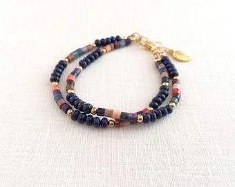 Lapis multi color sundance style bracelet. Blue lapis and gold, multi strand heishi stone bead bracelet. Lapis lazuli gemstone bead bracelet