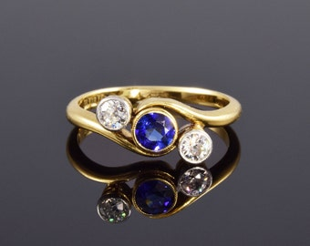 Antique engagement ring. Sapphire and diamond cross over ring circa 1915.