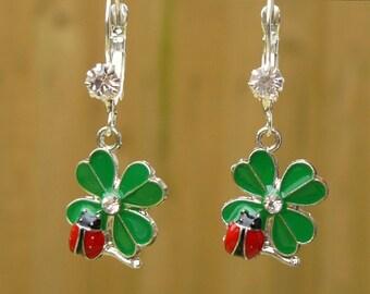 Enamel Ladybird earrings. Rhinestone lever back french hooks. Silver plated. Ladybird on clover earrings. Black velvet gift bag included.