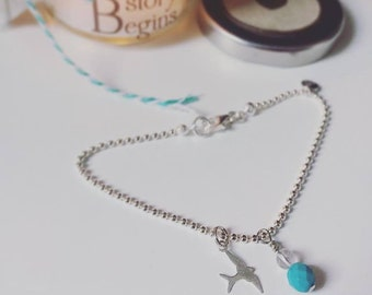 "A bead chain bracelet with charms Silver 925 and ""swallow"" gemstone pendant"
