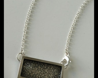 sterling silver necklace with textured plaque