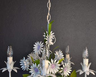 White toleware flower chandelier with daisies.
