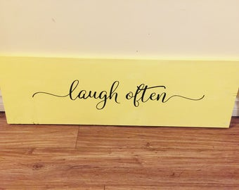 Laugh Often Pine Board Sign