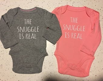 The Snuggle is Real - Long Sleeve Bodysuit- white writing