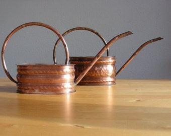 Set of 2 vintage copper watering cans,