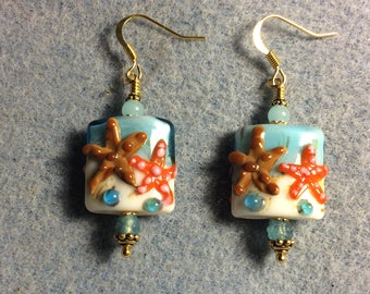 Light aqua, brown and orange lampwork starfish bead earrings adorned with light aqua Czech glass beads.