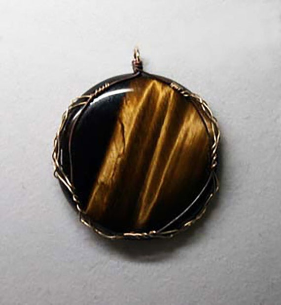 Tiger's eye cabochon wrapped in a Celtic style
