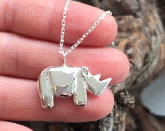 Silver rhino necklace, sterling silver rhino pendant, gorgeous chunky little rhino charm. Rhino Revolution charity donation from each sale.