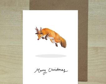 Cute christmas fox jumping xmas greeting card