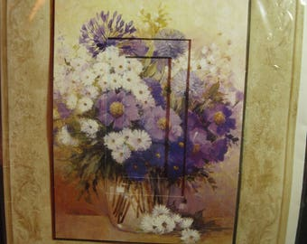 A Handmade Card with Purple and White Flowers in a Vase