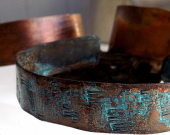 Trio of Copper Braclets hand cut with textured and Pantina