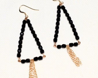 Black earring with glass beads and gold-plated chain