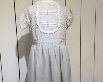 Original 1950's little girls party frock - Donned with polka dots, pearl buttons and pleats !