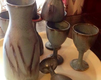 Superb service wine/water pitcher and 8 cups turned hand finished lava verdigris