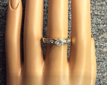 14K yellow gold diamond engagement ring.