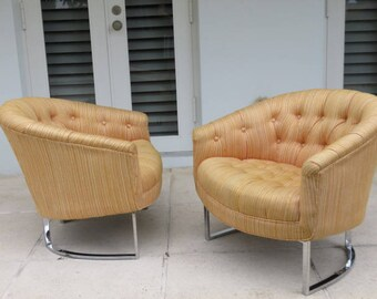 Pair Of Mid-Century Modern Chrome And Tufted Upholstery Barrel Back Lounge Chairs By Milo Baughman.