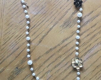 Pearl and enameled flowers necklace, gold and black