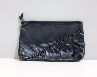 Vintage thin navy blue leather clutch