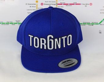 Blue Jay's/Maple Leaf Blue Tor6nto too! Beautiful 416 hats. Original Custom Snap backs CN Tower, 6ix, Area Code, 416 Hats, Roman Numerals