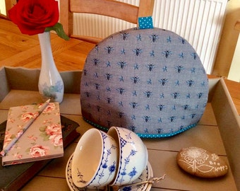 Tea cosy, Tea cozy with a honey bee print fabric. Pretty blue base fabric with a teal spot lining
